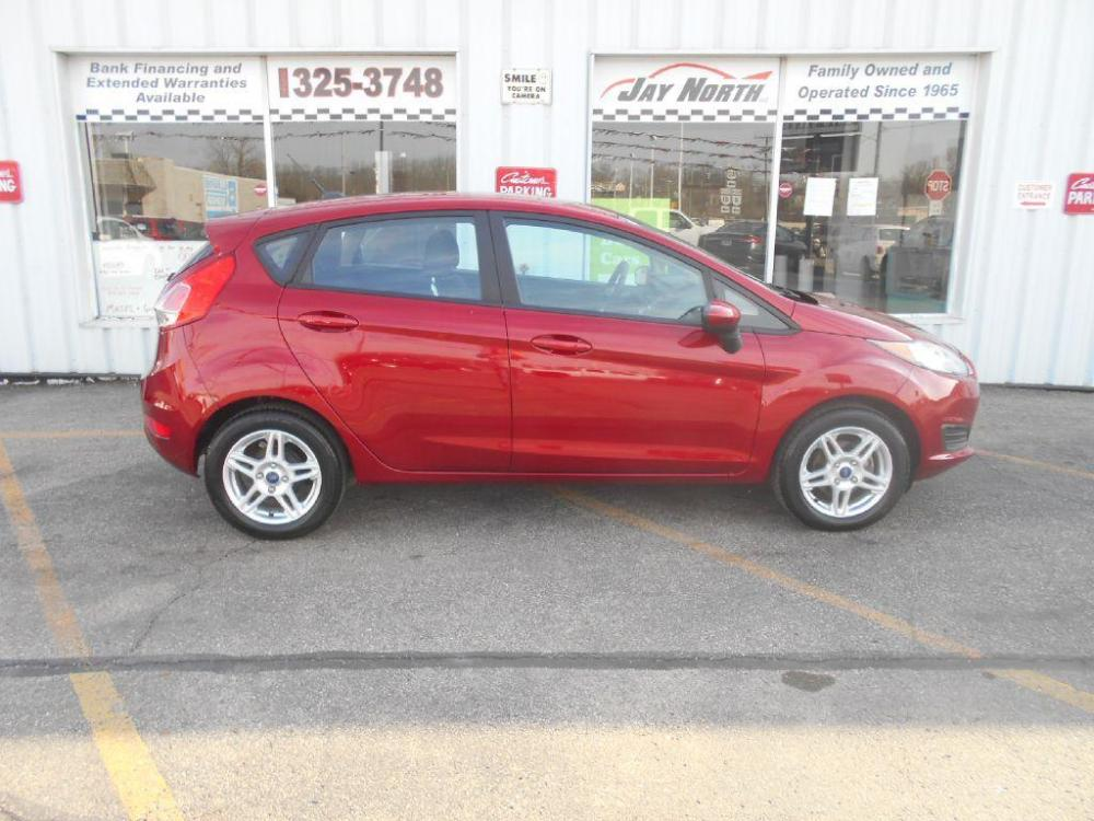2017 RED FORD FIESTA SE (3FADP4EJ2HM) with an 1.6L engine, Automatic transmission, located at 501 E. Columbia St., Springfield, OH, 45503, (800) 262-7122, 39.925262, -83.801796 - Photo #0